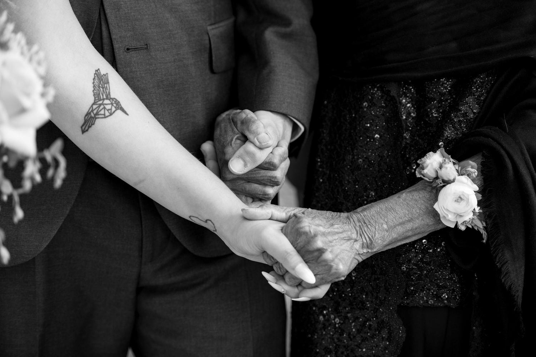Bride and Groom holding grandmas hands
