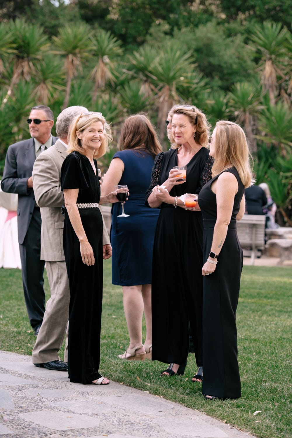 Wedding guests enjoying cocktail hour at The Stone House in Temecula, CA
