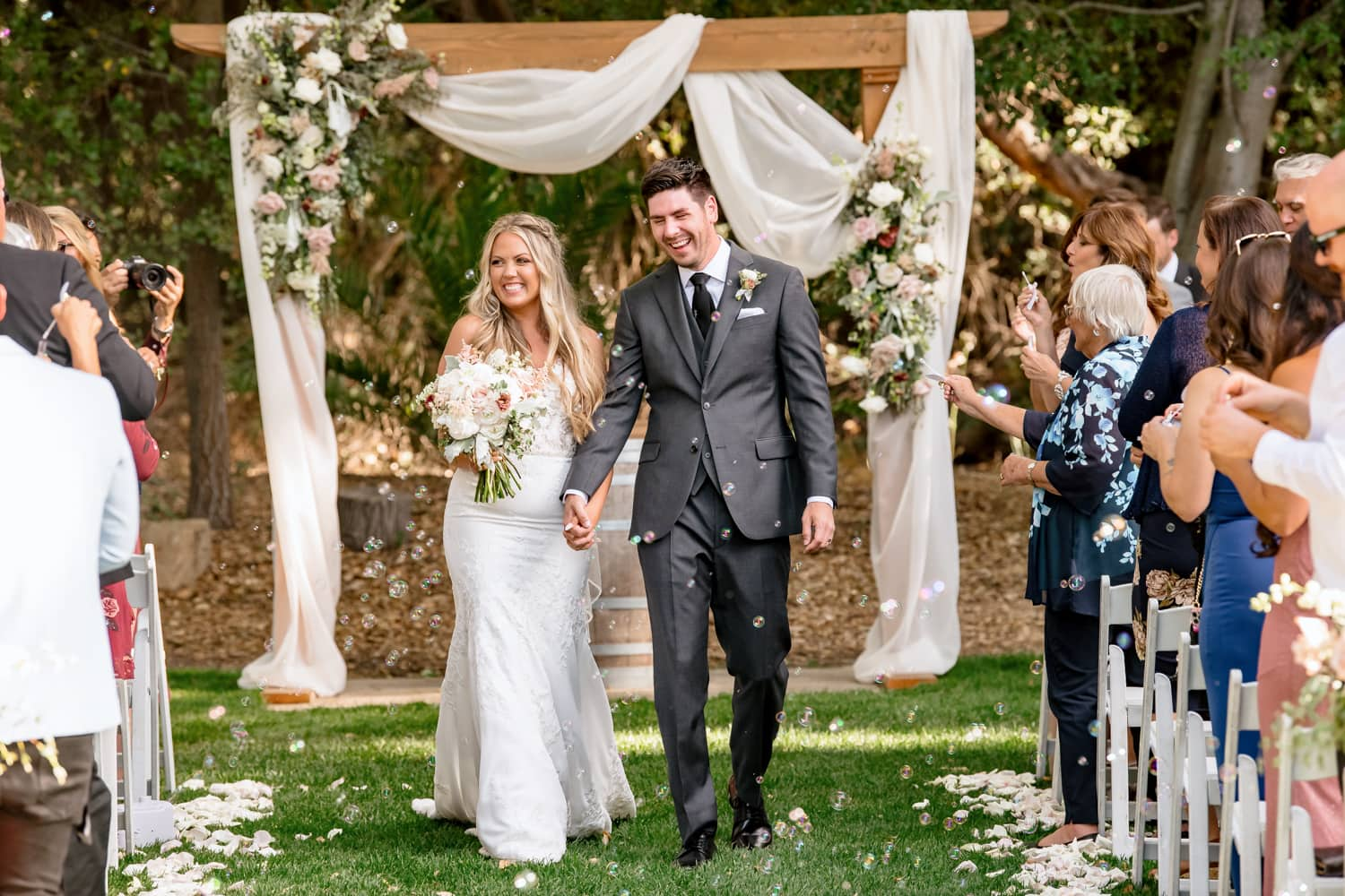 Bride and groom exiting wedding ceremony at The Stone House in Temecula
