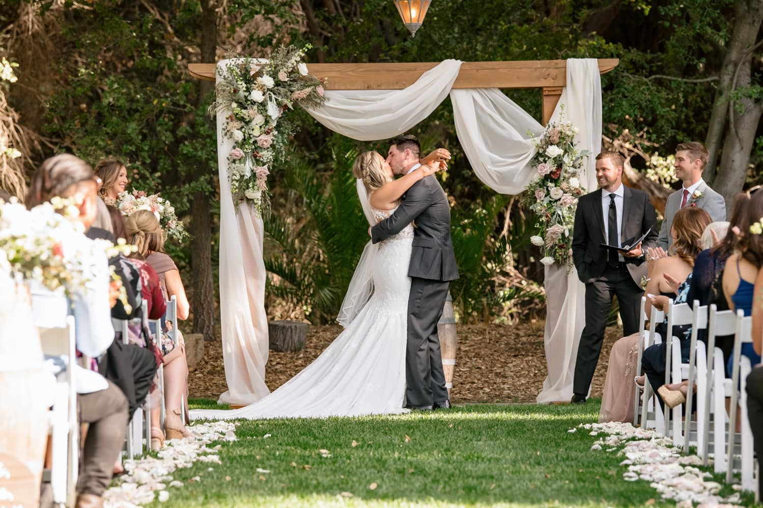 Couples first kiss at The Stone House ceremony site