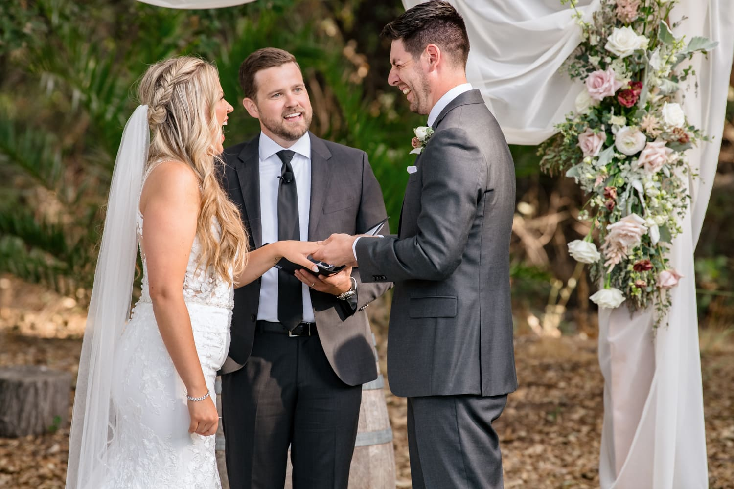 Ring exchange during ceremony at The Stone House in Temecula, CA