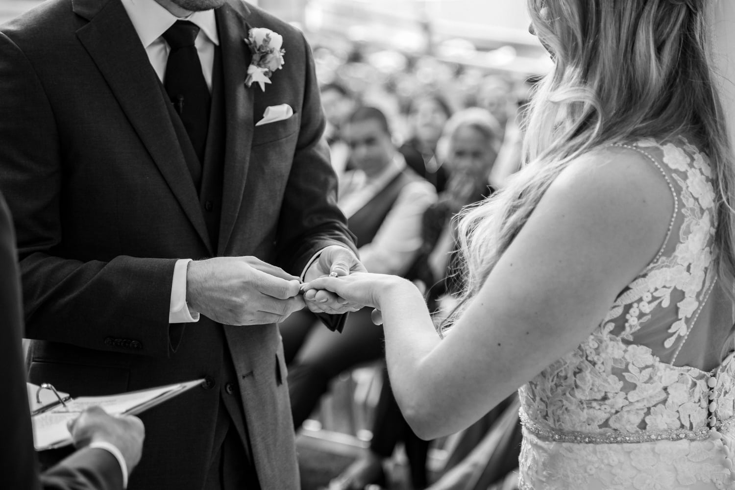 Couple exchanging rings at The Stone House in Temecula, CA