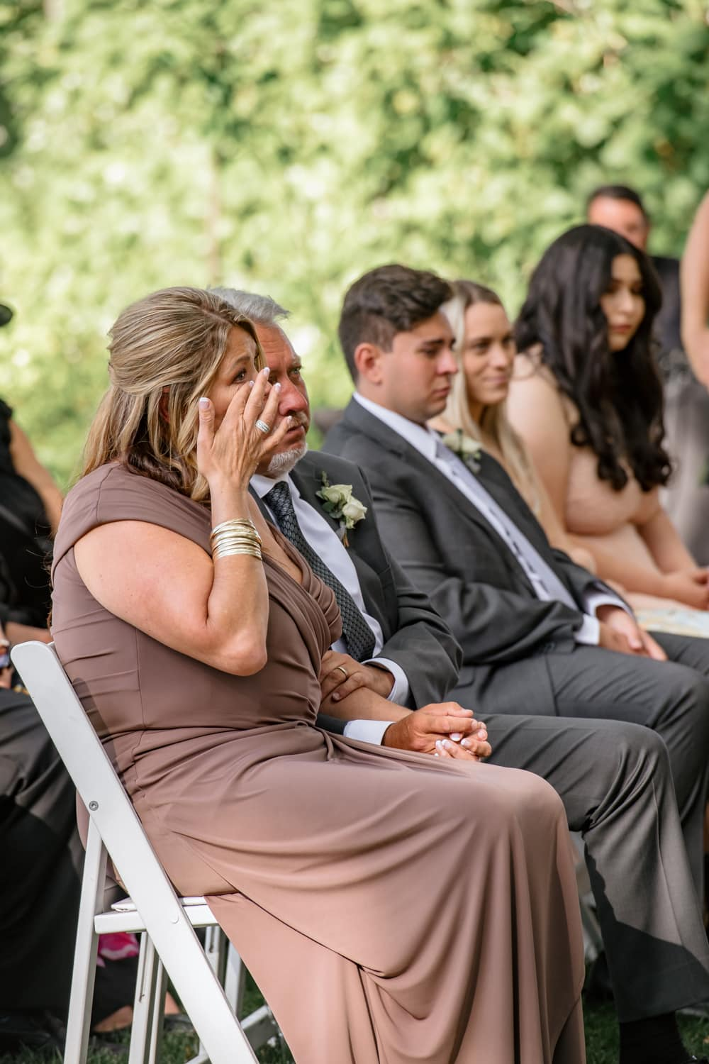 Mother tearing up during Temecula Creek Inn wedding ceremony