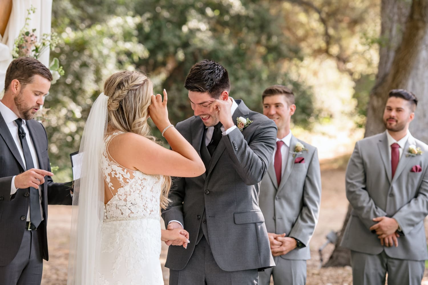 Bride and groom crying during wedding ceremony at The Stone House in Temecula, CA