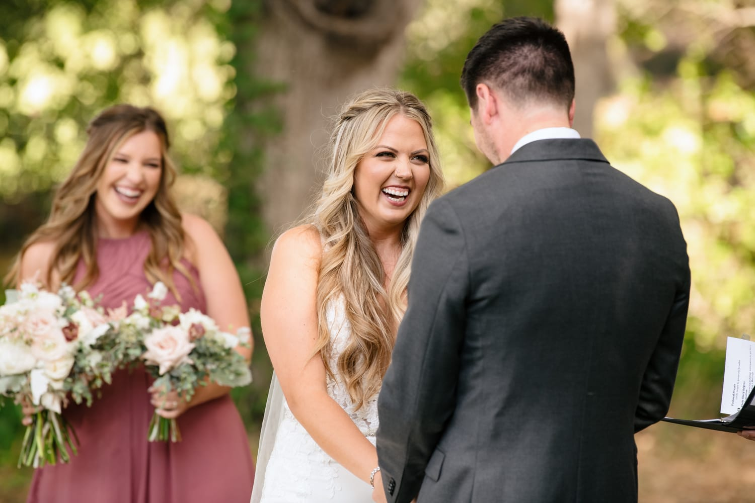Bride laughing at Stone House wedding ceremony at Temecula Creek Inn