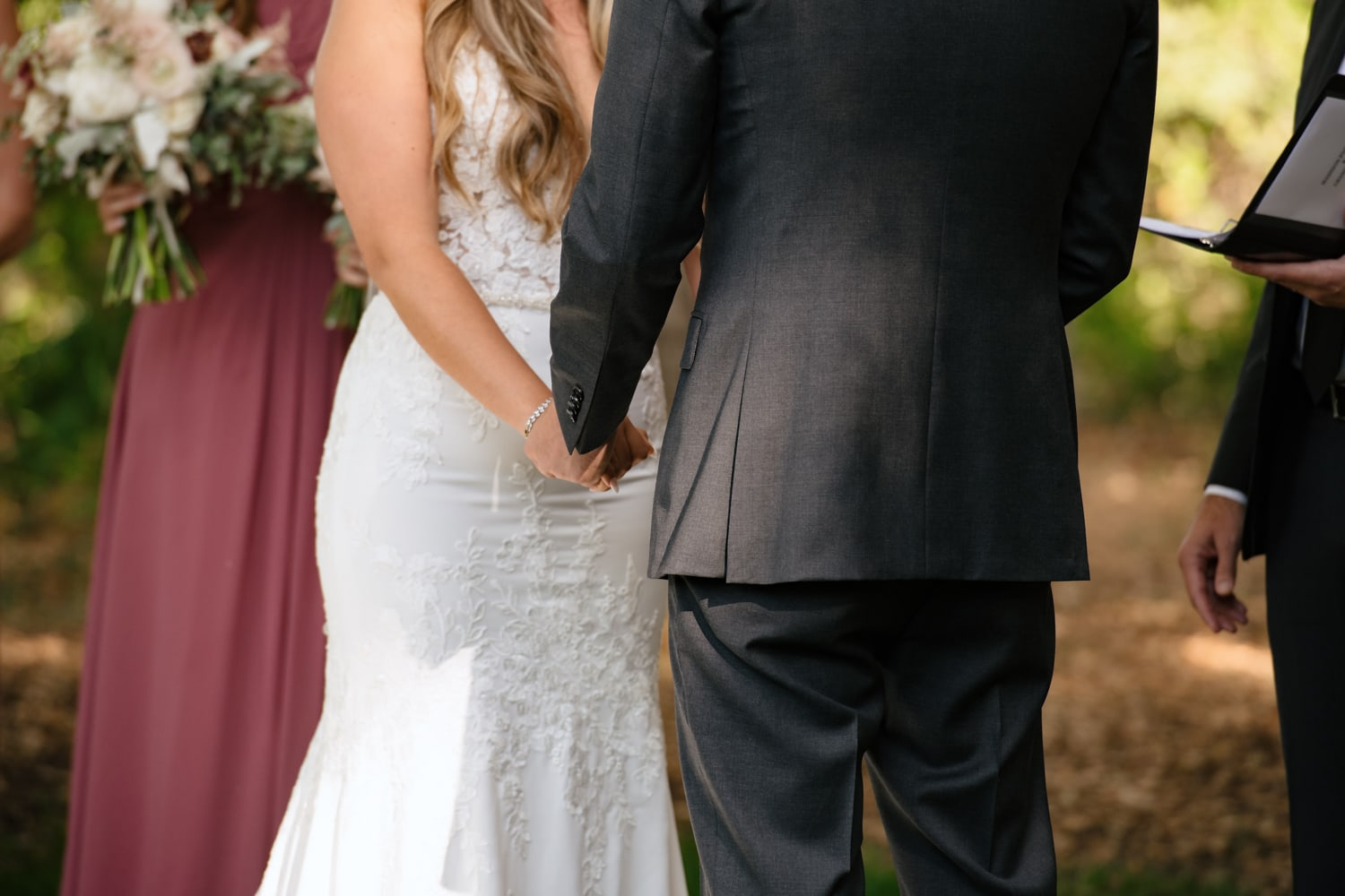 Bride and groom holding hands at The Stone House wedding venue
