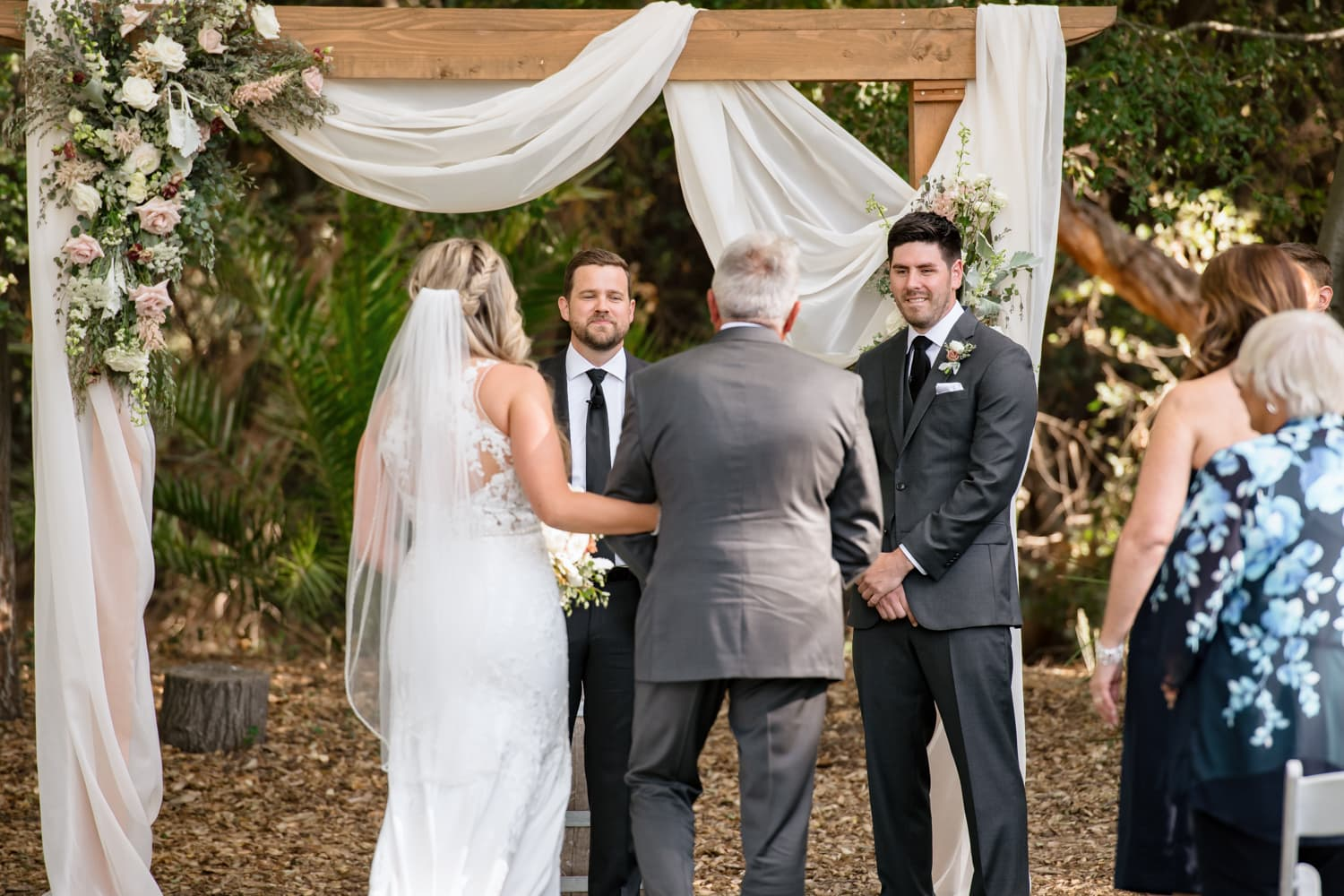 Father giving bride to groom at Stone House ceremony