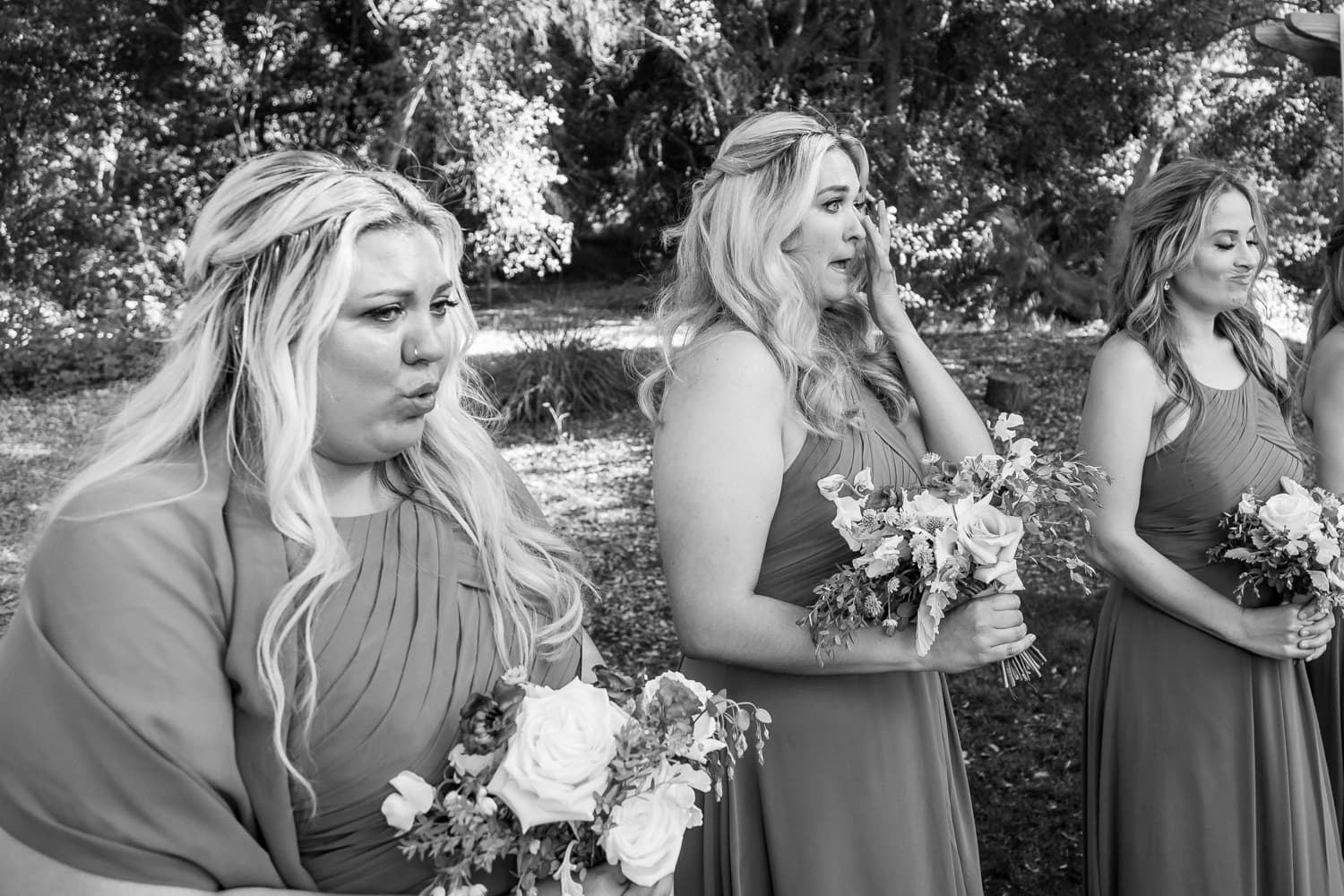 Bridesmaids crying during wedding ceremony at The Stone House