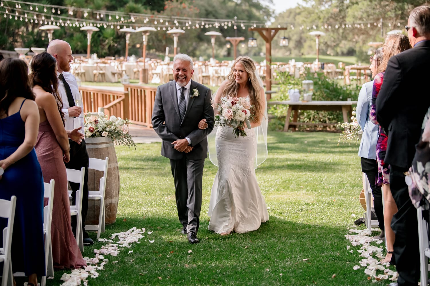 Bride and father walking down aisle at The Stone House