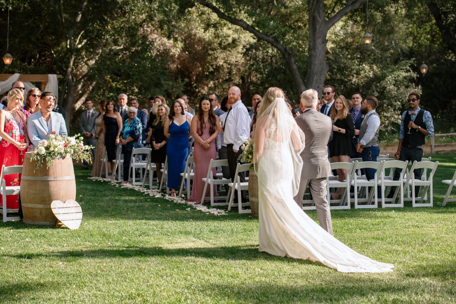 Bride and father walking down the aisle at The Stone House in Temecula, CA