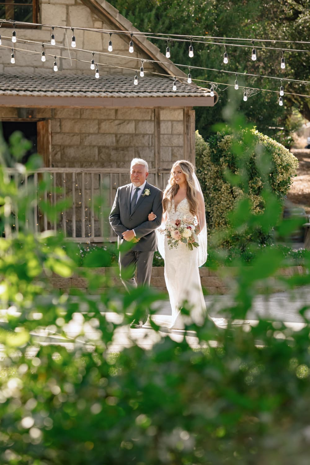 Bride and father walking to Stone House ceremony site